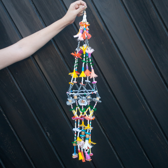 Pajaki Chandalier DIY Tutorial. A pajaki is a traditional Polish craft consisting of pom poms, straw and colorful paper | Gather Goods